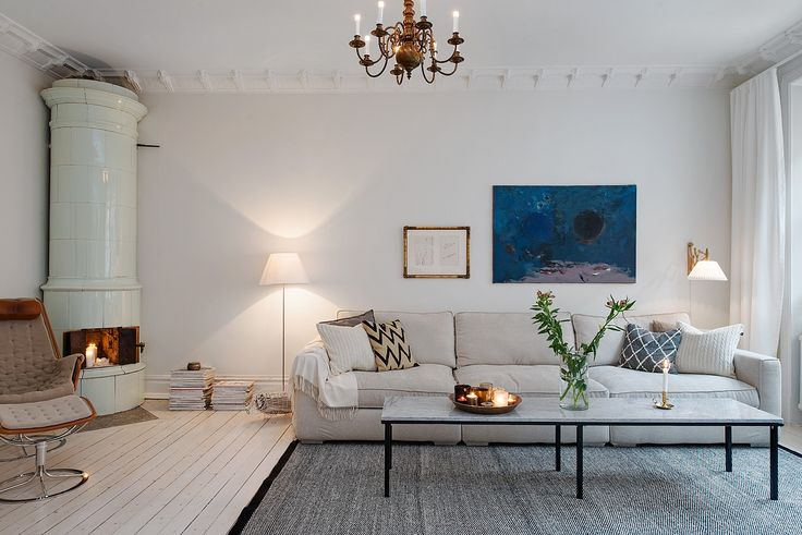 Scandinavian style home, gorgeous living room with soft neutrals and fireplace.