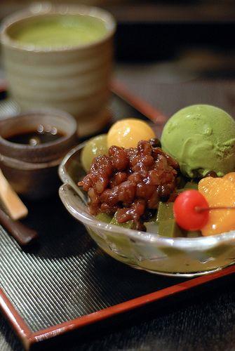 あんみつ (anmitsu) is an evolutionary form of みつまめ (mitsumámé) with a sweet red bean paste topping that comes with thick brown sugar syrup to pour over as desired. First served at 銀座 若松 (Ginza Wakamatsu) in 1930, Japan. ☆Mitsumámé is a dessert first sold in 1903 by 浅草 舟和 (Asakusa Funawa) consisting agar cubes, adzuki beans & fruits with plenty of light syrup moderately sweet to drink. Anmitsu in this pic also has 白玉 (shiratama), a rice flour dumplings & 抹茶 (matcha) ice cream for the toppings.