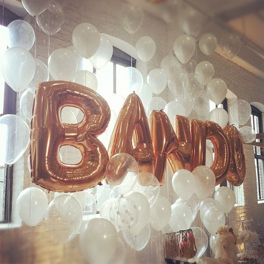 I could see this without the letters and instead of balloons, off white lace globes with nice lighting.  Great for a photo background.