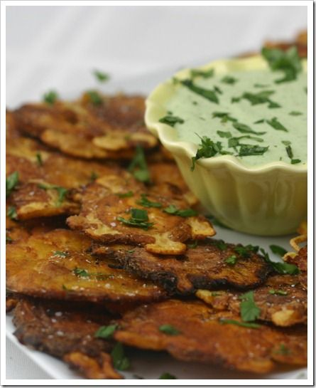 Tostones (fried plantains) with Creamy Garlic Cilantro dip. Cuban version of french fries...ADDICTING! Thanks @Stephy!