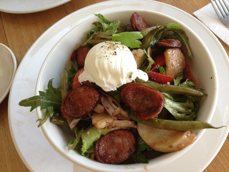 Grilled chorizo marinated red capsicum potato green beans red onion greens parsley balsamic and soft poached egg at Milkwood