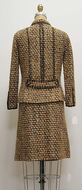"Suit House of Chanel (French, founded 1913) Designer: Gabrielle ""Coco"" Chanel (French, Saumur 1883–1971 Paris) Date: ca. 1962 Culture: French Medium: a) wool/mohair/synthetic, silk, plastic, metal; b,c) wool/mohair/synthetic, silk Dimensions: Length at CB (a): 23 1/2 in. (59.7 cm) Total Length (b): 9 in. (22.9 cm) Length at CB (c): 21 3/4 in. (55.2 cm) Credit Line: Bequest of Yolande Fielding–Scheftel, 2006"