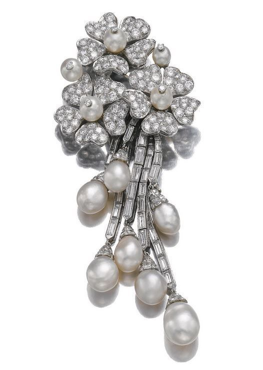 NATURAL PEARL AND DIAMOND BROOCH, VAN CLEEF & ARPELS, 1951. The surmount of floral design set with natural pearls and brilliant-cut diamonds, suspending lines of baguette diamonds, each terminating on a natural pearl drop,signed Van Cleef & Arpels and numbered.