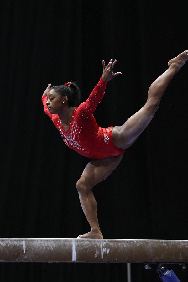 Gymnast Simone Biles (World Champions Centre) competes on the balance beam during the senior all-around competition.