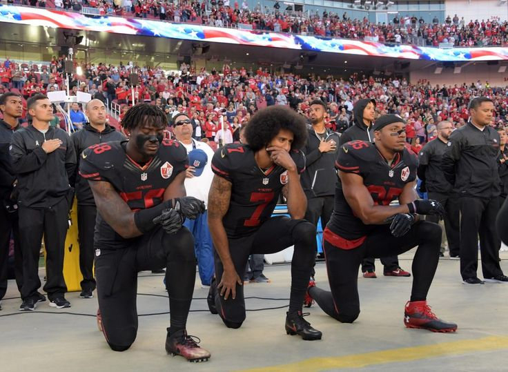 Oct 6, 2016; Santa Clara, CA, USA; San Francisco 49ers outside linebacker Eli Harold (58), quarterback Colin Kaepernick (7) and free safety Eric Reid (35) kneel in protest during the playing of the national anthem before a NFL game against the Arizona Cardinals at Levi's Stadium. Mandatory Credit: Kirby Lee-USA TODAY Sports - RTSR4IL
