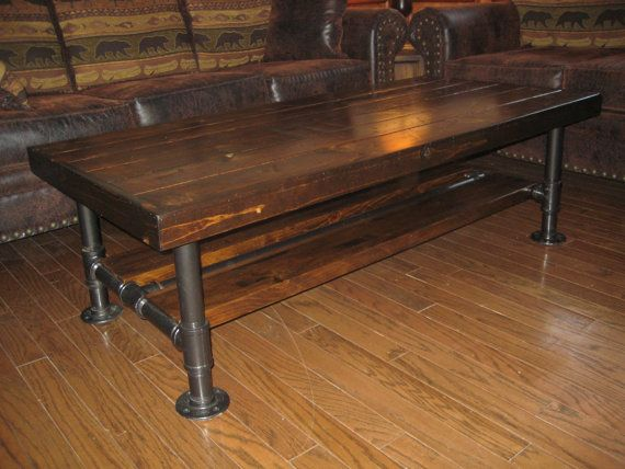 """Top 24"""" x 48""""  x 18"""" tall Distressed / Rustic Knotty Pine Coffee Table with Steel Pipe Legs with Lower Wood Shelf."""