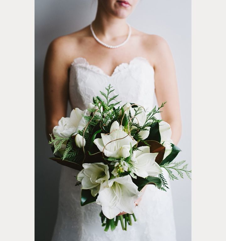 The Amaryllis has got to be one of our favorite winter flowers and instantly makes us think of Christmas!  These huge white flowers are stunning paired with magnolia leaves and pine.  Simply lovely and unique.