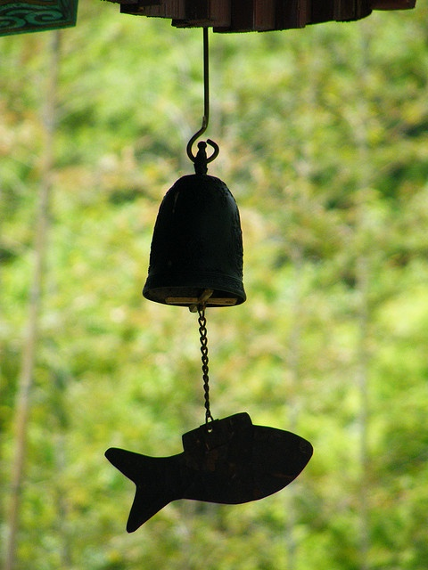 .Korean Temple bells hung at the corner of each eave--that way an evil spirit trying to get inside by climbing from the roof will be frightened away by the noise.  Really they are just lovely wind chimes.