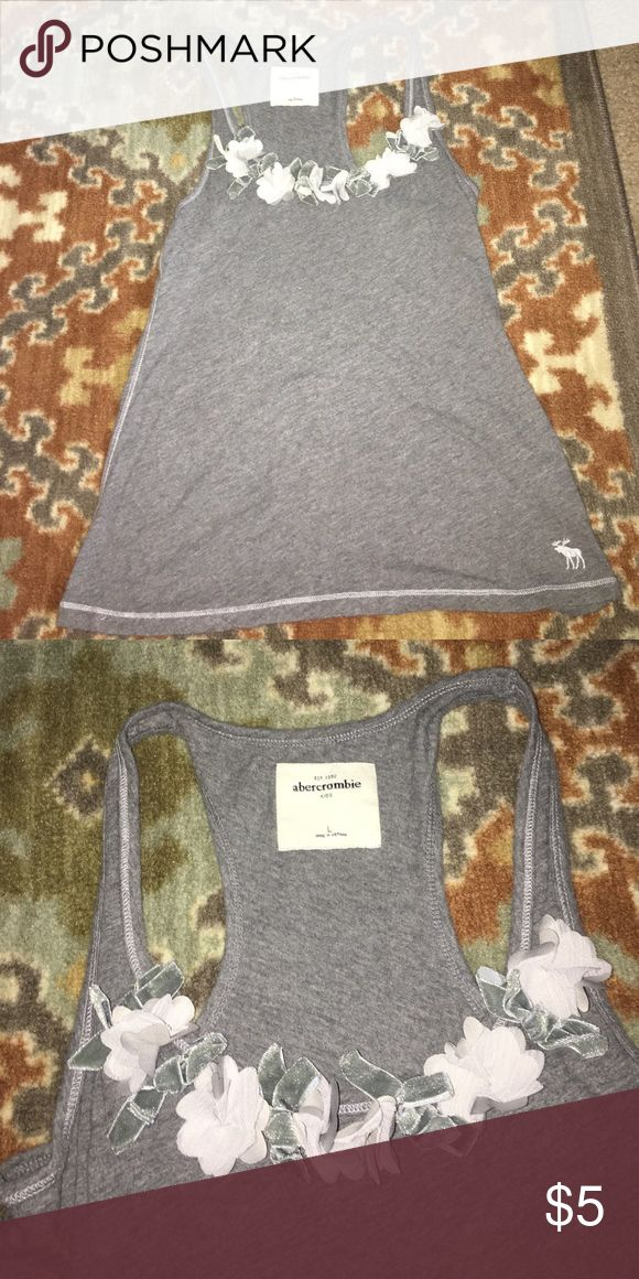 Abercrombie for kids tank Gray abercrombie for kids tank top in large. Has flowered and bows at neck and a razorback. Very cute for little girls going back to school! 😊 abercrombie kids Tops Tank Tops