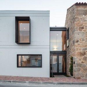 Filipe Pina + Maria Inês Costa add concrete  extension to stone house in Portugal