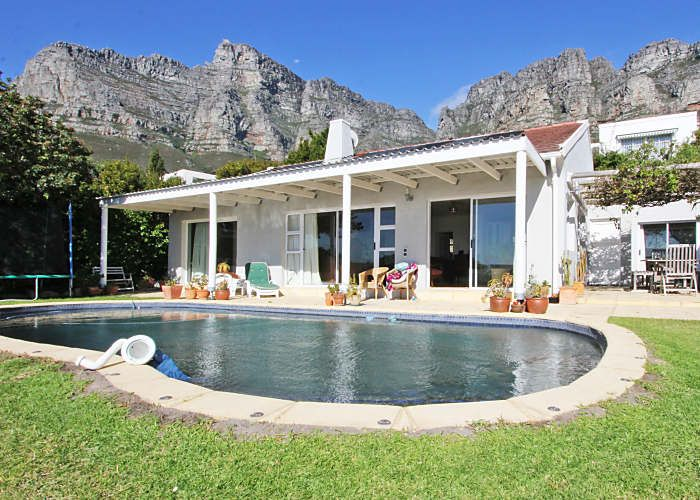 3 BEDROOM VACATION HOME CAMPS BAY, CAPE TOWN. Fiskaal House in the upmarket suburb of Camps Bay. Located on the serene slopes of Table Mountain. This comfortable beach style has lovely sea and mountain views from the pool and garden area where there is a trampoline for kids to enjoy.  Fiskaal House in Camps Bay has three double e-suite bedrooms all with double glazed sliding doors leading out to the patio. READ MORE HERE http://vacations.capetown/property/fiskaal-house/