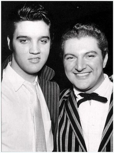Elvis & Liberace . Looks like a selfie, but don't think there was such a thing at that time.