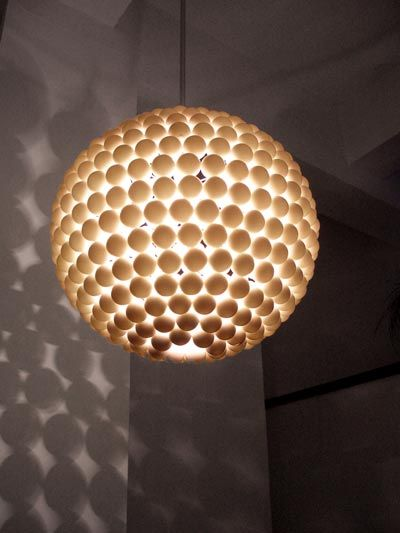 Don't put away that hot glue gun just yet! Now run out to Sports Authority and empty out their existing stock of ping pong balls. DIY instructions for this awe-inspiring ping pong pendant can be found here. Love the shadows it casts on the adjacent walls.
