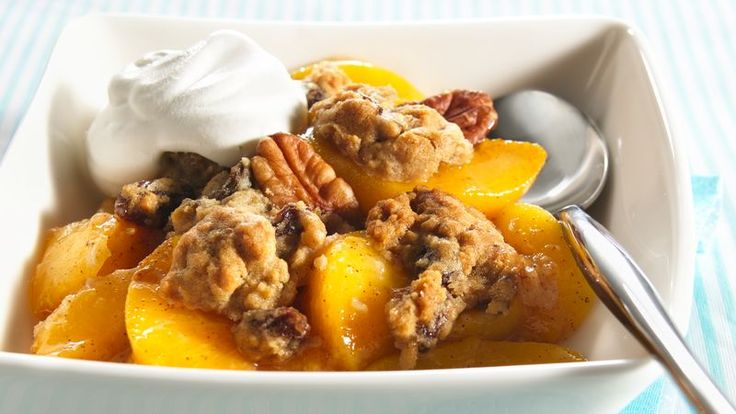 Pillsbury® Ready To Bake!® oatmeal cookies crumbled over a luscious peach filling make an old-fashioned dessert simply delicious!