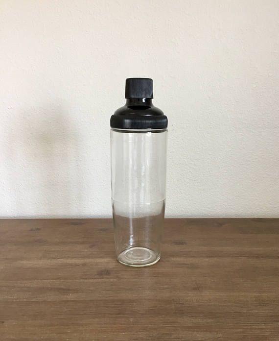 Vintage Glass Cocktail Shaker; Royal Crown Shaker; Vintage Barware; Cocktail Shaker; Mid Century Barware; Glass Shaker #RoyalCrownShaker #GlassShaker #VintageGlassShaker #ShakerWithLid #GlassDrinkMixer #VintageBarware #BlackLidShaker #ClearGlassBarware #RoyalCrownBarware #CocktailShaker