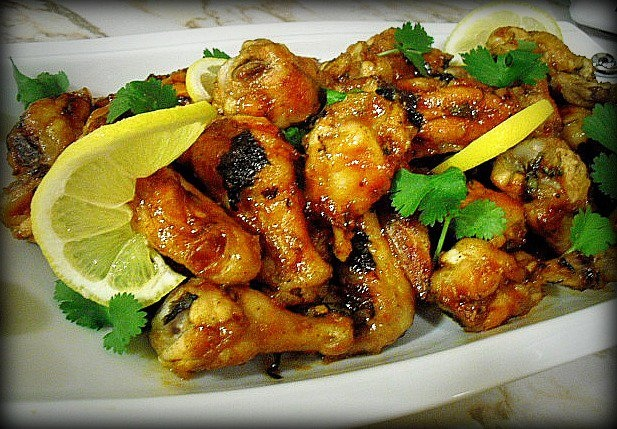 Wings marinated in cilantro, lime, garlic, buttermilk and whiskey. Glazed in apricot jam and baked in oven