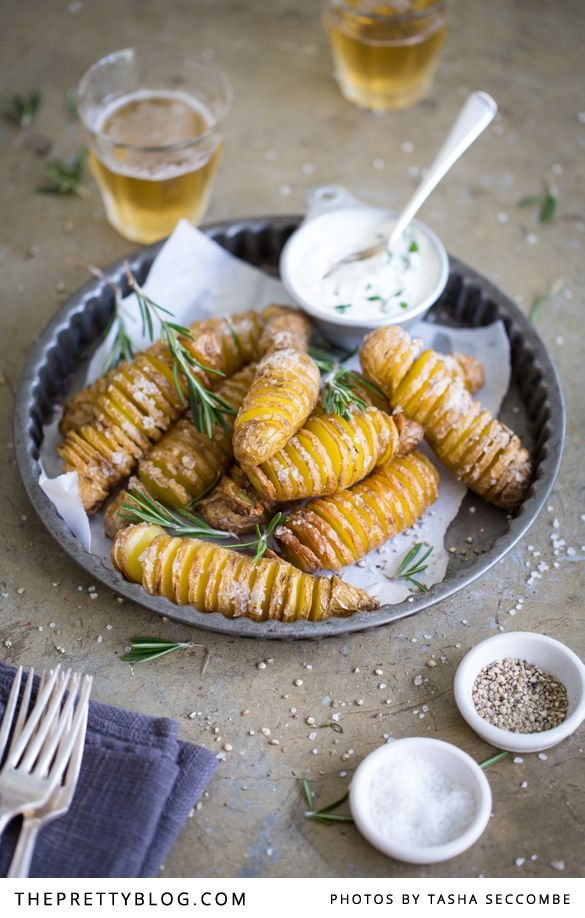 """I only discovered hasselback potatoes a few years ago at a birthday braai where my good friend Suné Rupping helped to cook side dishes for the hungry beer-drinking crowd. She made a huge tray full of hasselbacks, baked to golden perfection, crisp and magnificent.""""What on earth did you do to the potatoes?!"""" I exclaimed (with delight). Suné looked at me with a gleam in her eye. """"Don't you know hasselbacks?"""" Rhetorical question, of course. And the rest is history."""