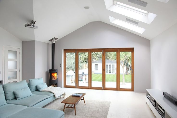 Victorian house with modern extension Large open plan living area/kitchen with wood burning stove Folding doors that ...