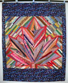 Scrap maple leaf quilt for Canada Quilts of Valor by Peter Newson