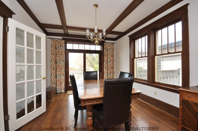 Dining room with wood trim and ceiling beams natural for Natural wood beams