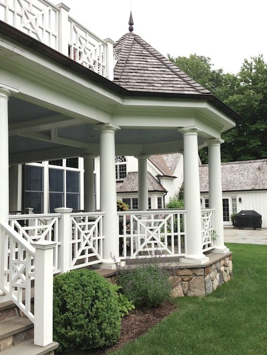 Taking a porch front or back and bumping out  the corner with a covered gazebo like structure adds a huge of architectural interest. Not to mention adding more sitting space. Railing etc should match the architecture of the building.