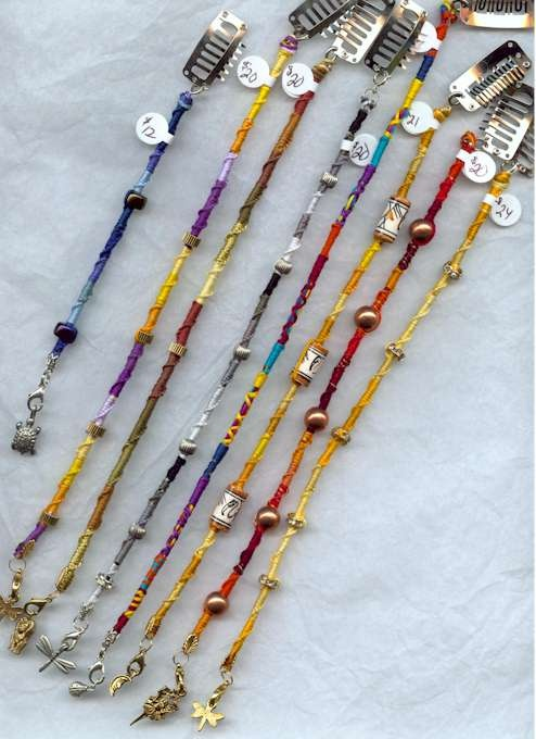 hair wraps, maybe for dreads....nice & pretty for any hair, mainly long, I could make these!
