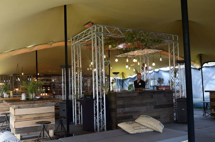 Central truss rig to support decorative lighting and create a feature-bar area.