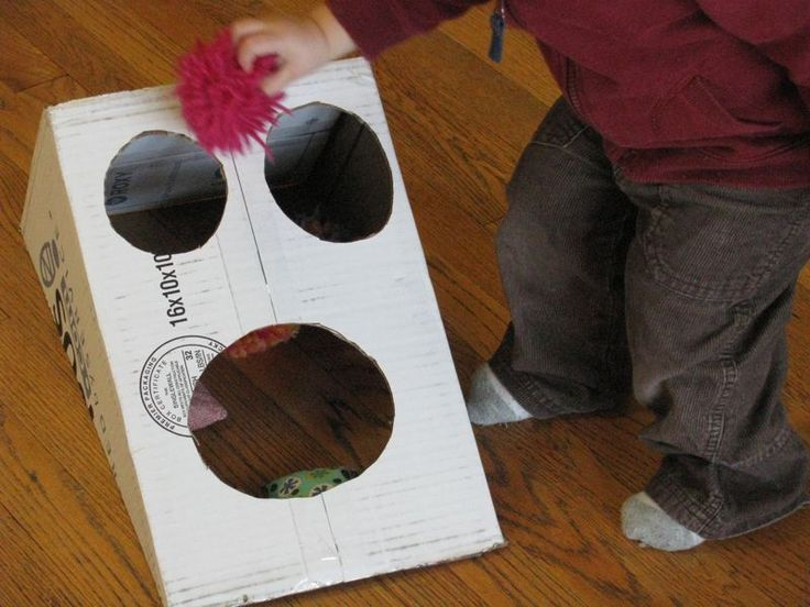 "Bean bag toss out of a cardboard box. I imagine it would be easy to make it more ""pretty"" and fun-looking"