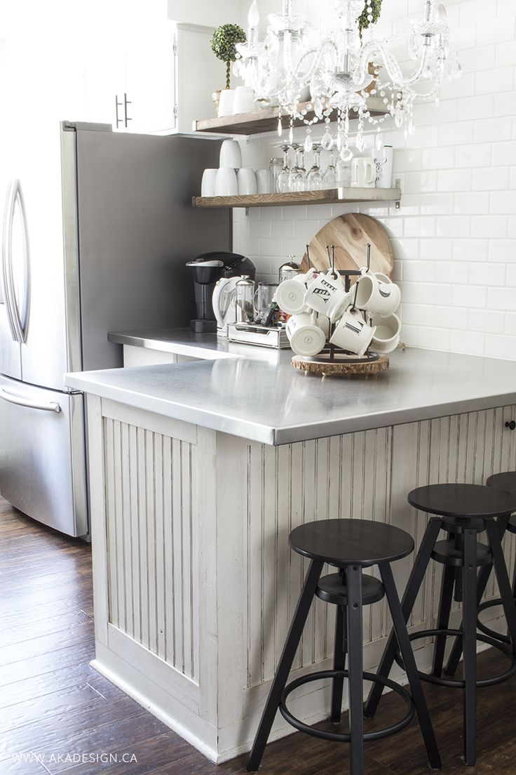 Cute little breakfast bar with black stools & chandelier - open shelving for this little coffee area!