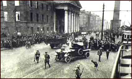 An armoured car kept the crowd on the move in O'Connell street near the GPO, Dublin while a raid for arms was taking place in the vicinity. It was from the steps of the GPO that Patrick Pearse read the proclamation of the Irish republic on Easter Monday 1916. The rebels held the post office for five days. ©