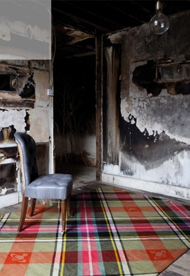 This distressed British interior is the perfect example of the Punk influence today, in both street and high-end culture. The raw and exposed walls fight against the colourful quintessential tartan of The Rug Company's Fire Aubusson Tapestry Rug with Howe London's Irish Beetle Linen Salon Chair, designed by none other than the Queen of Punk herself, Vivienne Westwood.