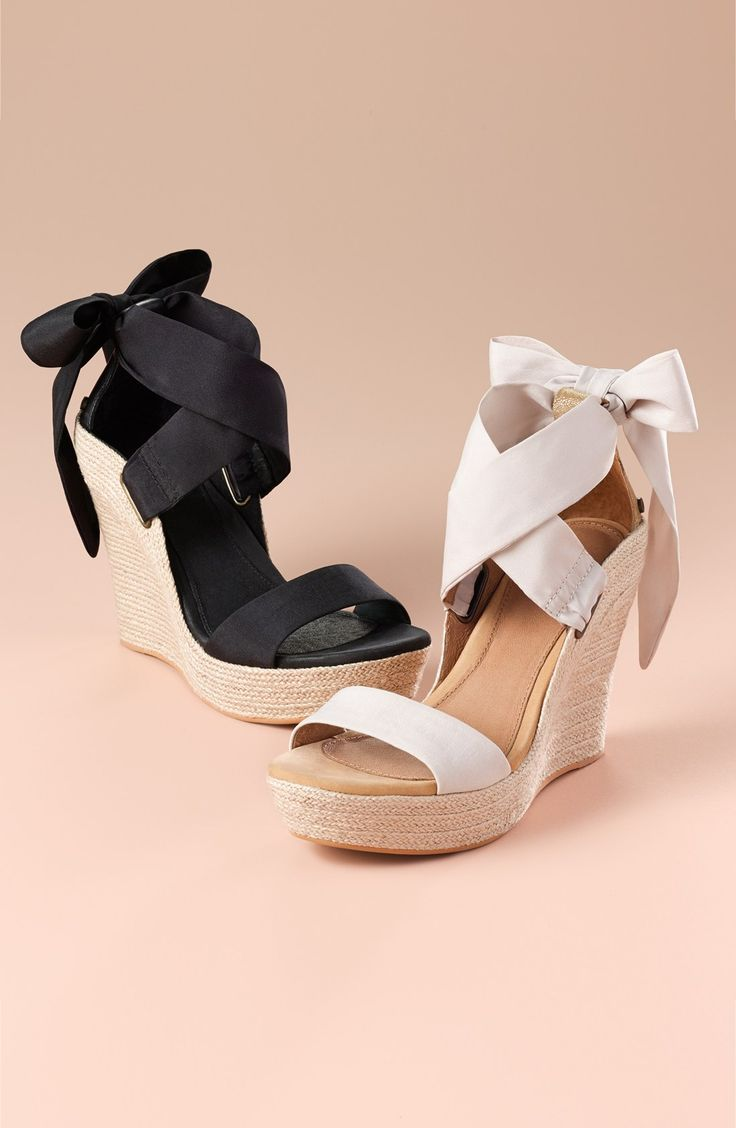 In love with these charming platform wedges with crisscrossing, ankle-wrap laces. A perfect bow in the back adds a cute touch.