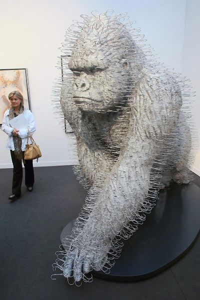 David Mach, a sculpture and installation artist, creates art entirely from wire coat hangers.