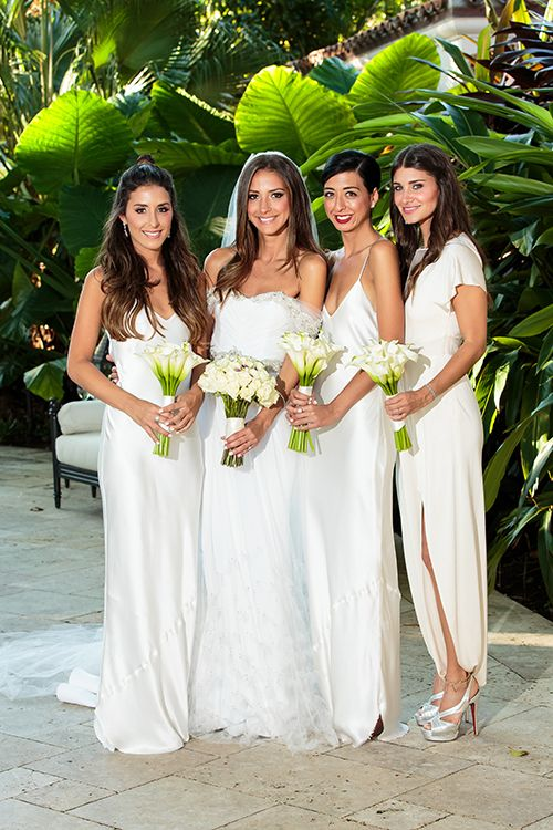 White bridesmaids dresses by @nililotan, inspired by Carolyn Bessette Kennedy   @fredmarcus   Brides.com
