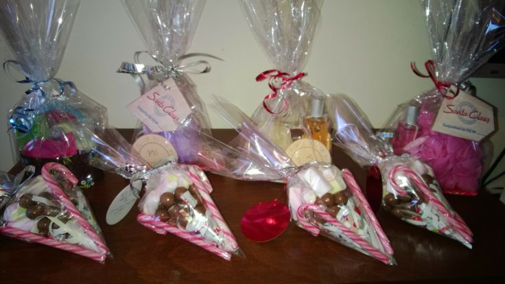 Simple but beautiful and personal gifts. Not just for Christmas. Marshmallow and malteser cones. Make the cone with cellophane, either put some brown paper at the bottom in a cone shape to define the point or fill with tissue wrap or cotton etc, add maltesers and marshmallows. fasten with a ribbon and stick 2 candy canes on outside with normal tape and ta dah!