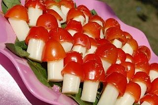 Fairy food.  Cherry tomatoes toothpicked to a mozzerella string cheese stick!