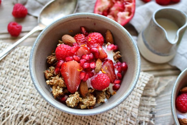Roasted Vanilla Strawberries topped with Almond Granola, Raspberries and Pomegranate