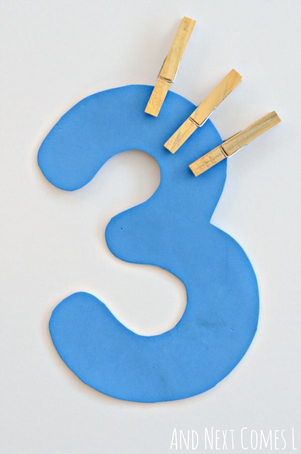 Fine motor counting for toddlers and preschoolers using clothespins from And Next Comes L