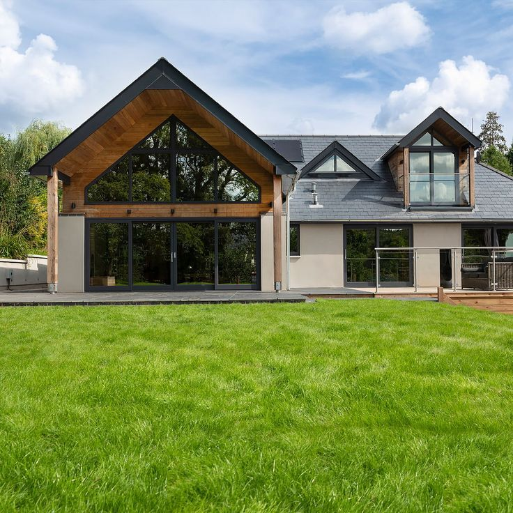 Rear Exterior Of A Modern New House With Timber Cladding Building Your Own Home And The Cost Build Your Own House Modern House Exterior House Designs Exterior