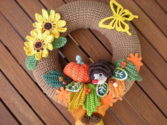 This is a PDF PATTERN for Crochet Autumn Door Wreath. The pattern is very…
