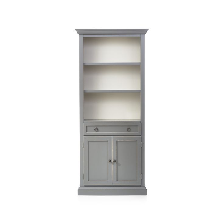 Shop Cameo Grey Storage Bookcase.   The storage bookcase with two shelves and an enclosed cabinet with drawer for games, remotes and DVDs combines with the media storage pieces for the look of a custom built-in.