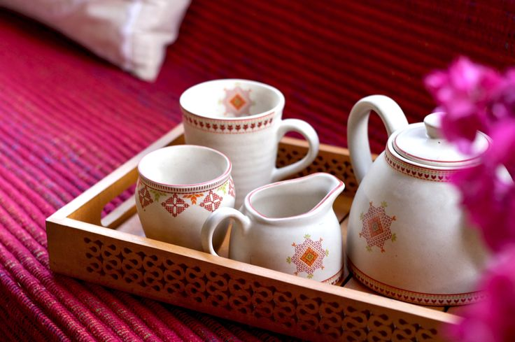 #tableware #ceramic #teatime #white #orange #motifs #teaset #tray #wood #cutwork #kitchenware #giftables #giftware #home #lifestyle #Fabindia