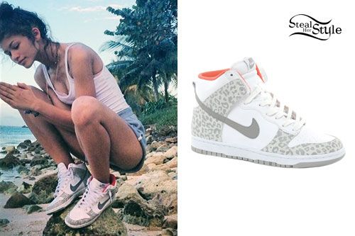 Zendaya wore a pair of Nike Dunk Gray Leopard High Top Sneakers (sold out) during her recent trip to Jamaica. You can buy the same style of Nike Dunk High Sneakers in many more prints and colors for $85.00 to $145.00.