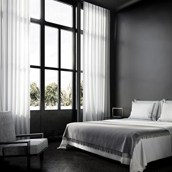 love the elegant minimalistic approach of this all black bedroom via