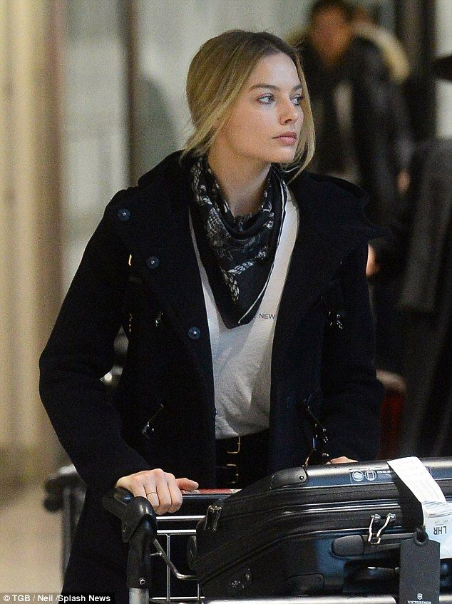 Gorgeous: The 25-year-old didn't look a touch fatigued as she made her way through the ter...
