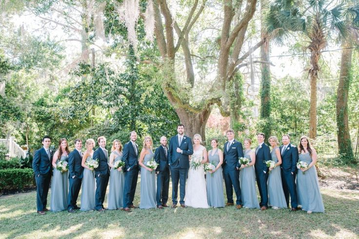Groomsmen in navy blue suits and bridesmaids in light blue Jenny Yoo gowns at a wedding in Beaufort, SC // Aaron and Jillian Photography » International Wedding Photographers based in Charleston, South Carolina.