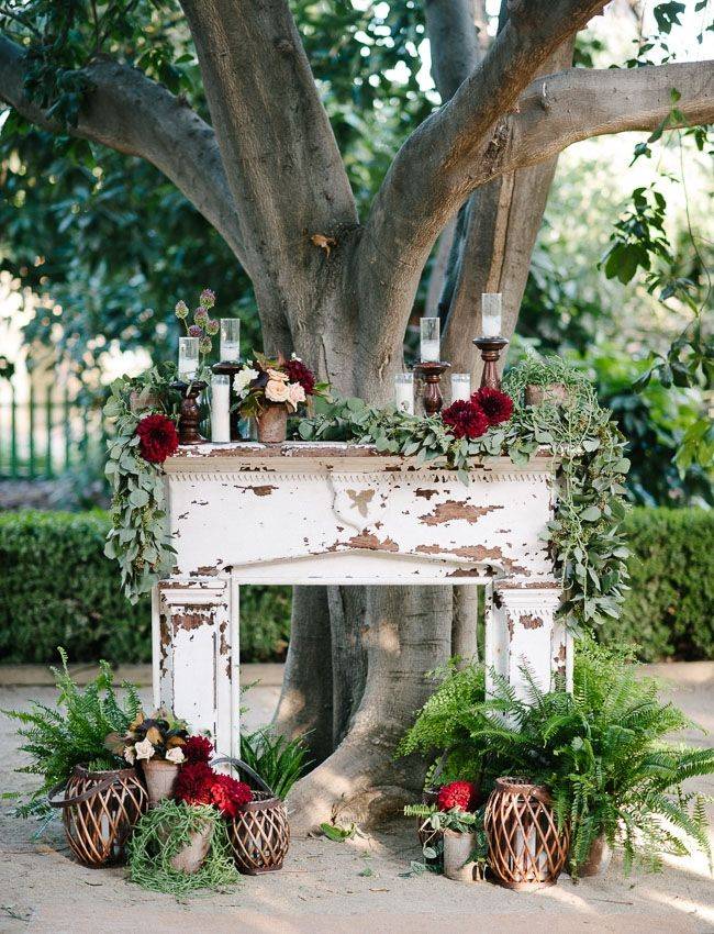 This shabby chic fireplace mantle is a super cute fall/winter decor option! | 15 Fun Fall Wedding Ideas on The Bride Link