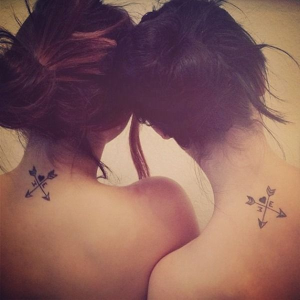 Matching arrow tattoos for sisters