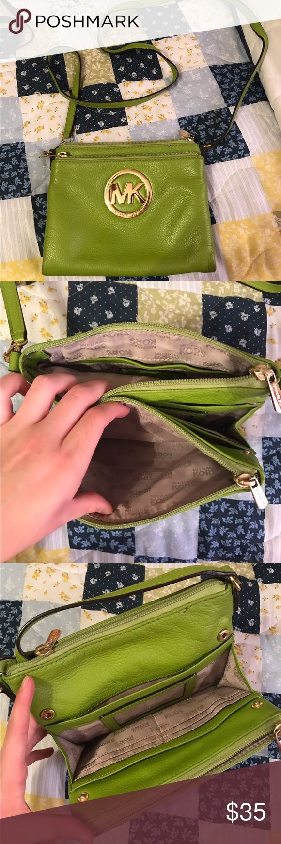 Green Michael Kors cross body purse This is a small cross body purse, has many pockets and slots for your cards and etc. Perfect size for traveling or just packing everyday! In good condition. Michael Kors Bags Crossbody Bags