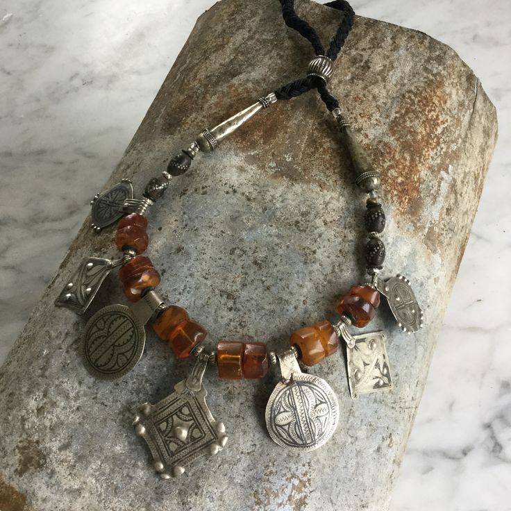 Necklace of Old Baltic Amber sliced, old silver Moroccan niello pendants, old silver studded black coral beads and Moroccan cones. #savannacaravan